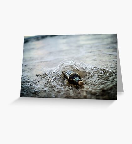 Message in a bottle - a bottle half buried in sand on a beach  Greeting Card