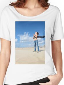 Spiritual young woman communicates with the spirits on a beach Women's Relaxed Fit T-Shirt