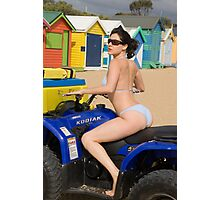 Female bikini model on rescue ATV at Brighton Beach in front of the bathing boxes Photographic Print