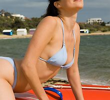 Female bikini model on rescue dinghy at Brighton Beach in Melbourne Victoria Australia by leoklein