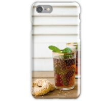 Glass of mint tea with sesame cookie, close-up  iPhone Case/Skin