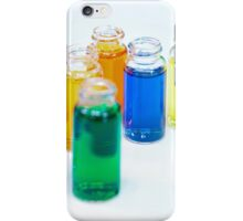 Glass bottles with coloured liquid at a Cosmetics manufacturer iPhone Case/Skin