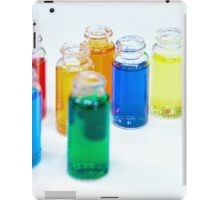 Glass bottles with coloured liquid at a Cosmetics manufacturer iPad Case/Skin