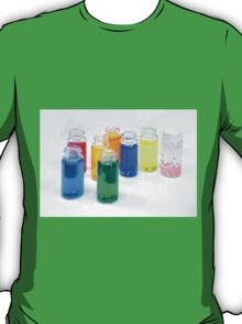 Glass bottles with coloured liquid at a Cosmetics manufacturer T-Shirt