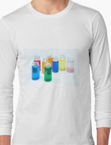 Glass bottles with coloured liquid at a Cosmetics manufacturer Long Sleeve T-Shirt