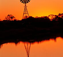 Windmill reflected at sunset by Speedy