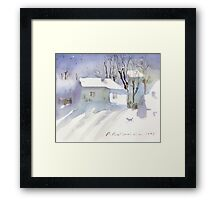 Village house covered in snow Framed Print