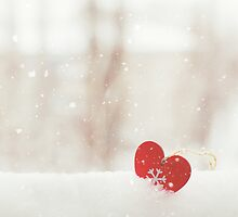 Small red heart in the snow by Olja Merker