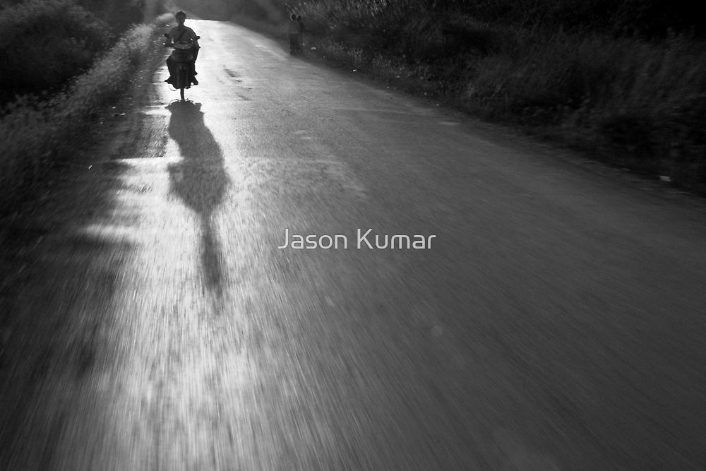 lao cruising on a moped by Jason Kumar