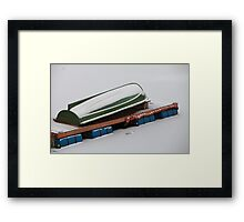 Winter covered with snow rowing boat Framed Print