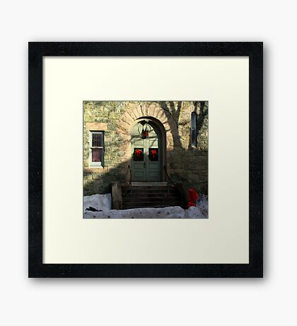 Church door decorated for Christmas. Framed Print