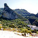 Behind Agios Gordios Beach by Tom Gomez