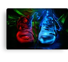 Old boots painted with light Canvas Print