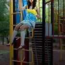 Forgotten doll in a play yard... by Tatiana R