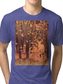 Silhouette of a stag in the forest at the autumn time Tri-blend T-Shirt