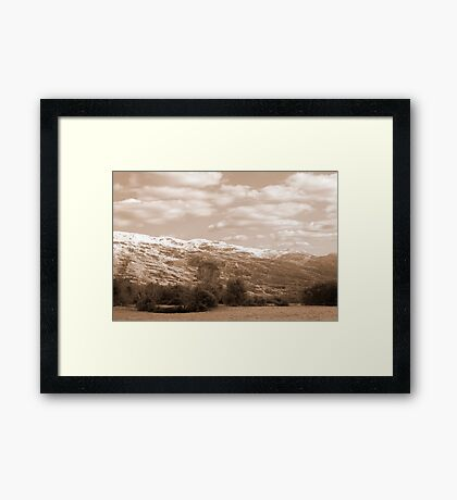 rocky mountain and fields countryside snow scene Framed Print