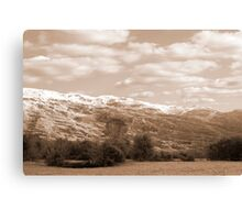 rocky mountain and fields countryside snow scene Canvas Print