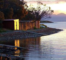 Sunset over Red Ochre Boat Sheds by Eve creative photografix