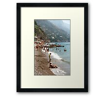 Lady on a beach in Positano, Italy Framed Print