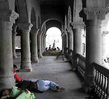 A couple visiting a cenotaph in Indore falls asleep while the child looks on ,fiddling with a cell phone by nisheedhi