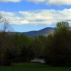 Majestic mountains over looking  a Tranquil pond. by spiritsfreedom