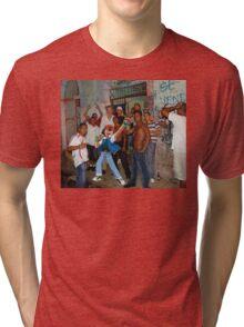 It's a pokemon world. Tri-blend T-Shirt