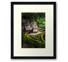 Cottage in the gardens Framed Print