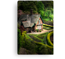 Cottage in the gardens Canvas Print