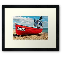Lonely fishing boat on the pebble beach Framed Print
