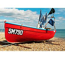 Lonely fishing boat on the pebble beach Photographic Print