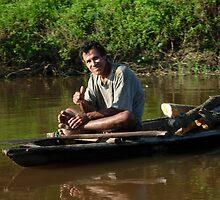 Peruvian in small boat, Amazon, Peru, near Iquitos by Maurits de Graaf