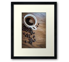 Espresso and beans on a table Framed Print