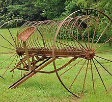 rusty hay rake by A.R. Williams