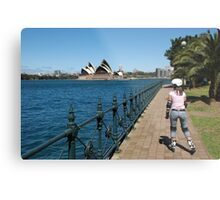 Girl rollerblading along the Sydney Harbour foreshore with the Opera House in the background Metal Print