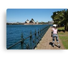 Girl rollerblading along the Sydney Harbour foreshore with the Opera House in the background Canvas Print