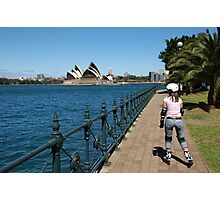 Girl rollerblading along the Sydney Harbour foreshore with the Opera House in the background Photographic Print