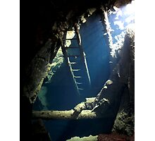 Old ladder leading down to long flooded workings in a old copper mine, Devon. Photographic Print