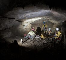 Meal stop in gallery forty-two, Dent De Croll plateau cave system, south eastern France. by ferret