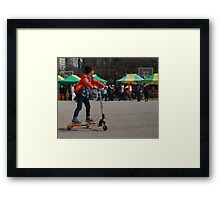 Korean Boy on a 3 Wheeled Scooter (1) Framed Print