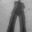 Small man, long shadow by Lior Goldenberg