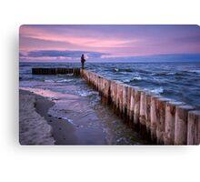 Sunset fishing on breakwater Canvas Print