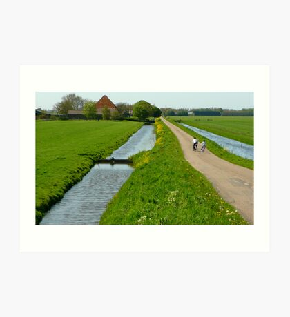Cycling home in polderland Art Print