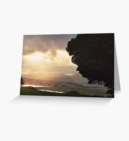 Sunset through the clouds Greeting Card