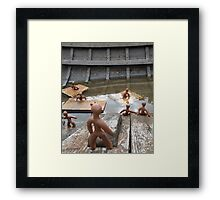 Clay People- in an old boat Framed Print