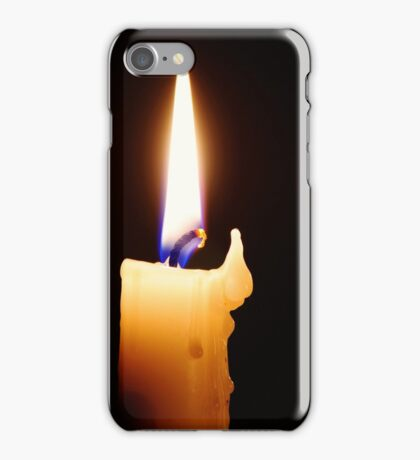 Candle with melted wax against dark background. iPhone Case/Skin