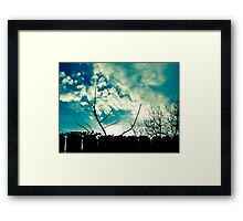 clouds trees and fence Framed Print