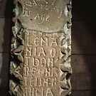 Close up of Inscription in wall niche Lanercost Priory Cumbria England 198405260022 by Fred Mitchell