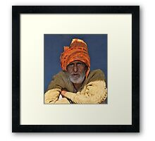 Shopkeeper In The Shadows Framed Print