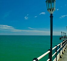 The Pier Over The Green Sea And Under The Blue Sky by Nick Sladden
