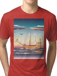 Old sailing ship on the open ocean at sunset Tri-blend T-Shirt